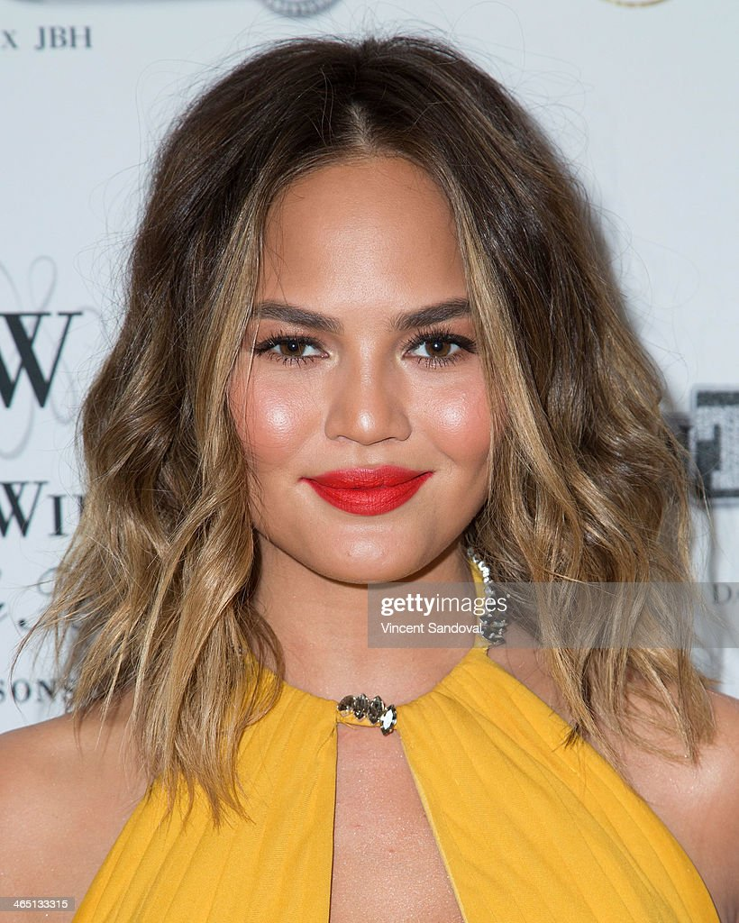 Model <a gi-track='captionPersonalityLinkClicked' href=/galleries/search?phrase=Christine+Teigen&family=editorial&specificpeople=4583768 ng-click='$event.stopPropagation()'>Christine Teigen</a> attends Jason Of Beverly Hills' Pre-GRAMMY cocktail hour and salute to fashion icon David Thomas' Gentleman Collection at The Blvd on January 25, 2014 in Los Angeles, California.
