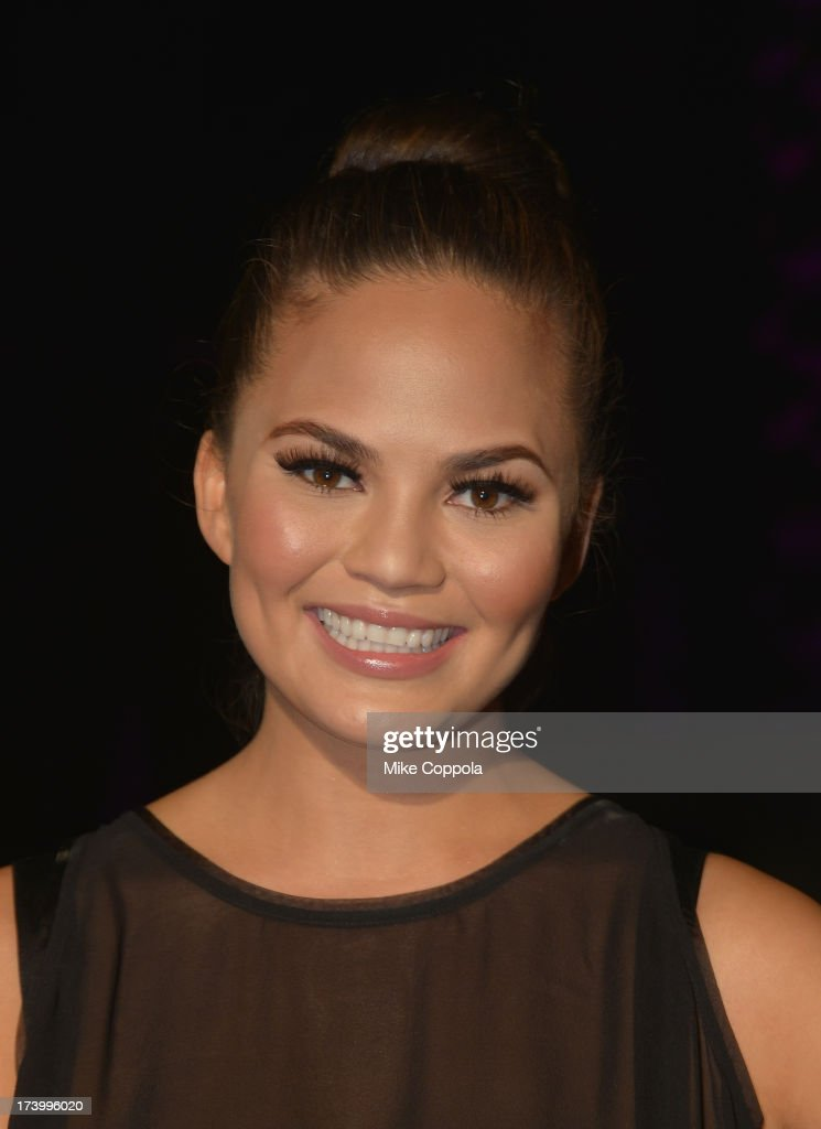 Model <a gi-track='captionPersonalityLinkClicked' href=/galleries/search?phrase=Christine+Teigen&family=editorial&specificpeople=4583768 ng-click='$event.stopPropagation()'>Christine Teigen</a> attends the official kick off party for Mercedes-Benz Fashion Week 2014 Official Coverage - Day 1 at Raleigh Hotel on July 18, 2013 in Miami Beach, Florida.