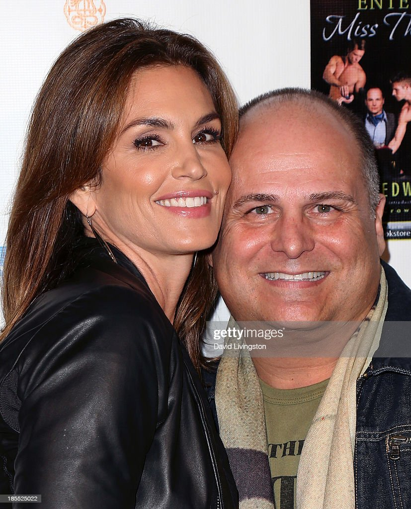 Model <a gi-track='captionPersonalityLinkClicked' href=/galleries/search?phrase=Cindy+Crawford&family=editorial&specificpeople=202842 ng-click='$event.stopPropagation()'>Cindy Crawford</a> (L) and celebrity talent executive/author Brian Edwards attend the launch party for Brian Edwards' book 'Enter Miss Thang' at Cafe Habana on October 21, 2013 in Malibu, California.