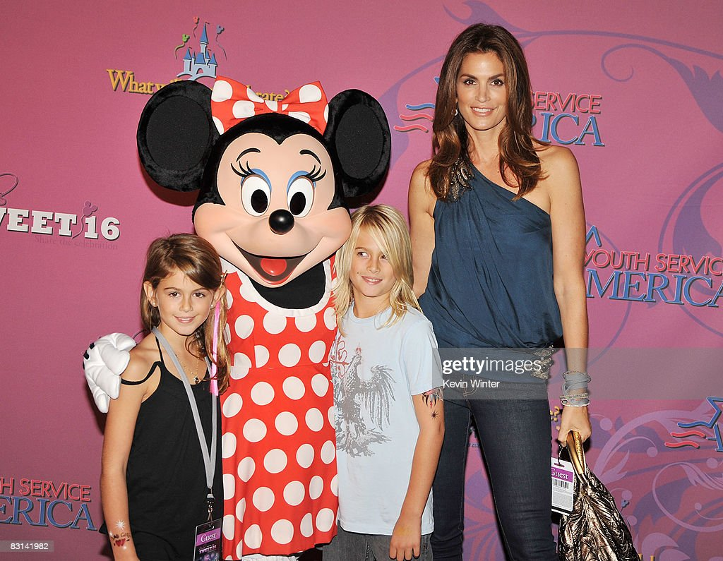 Model Cindy Crawford and her children Kaia (L) and Presley arrive at Miley Cyrus' 'Sweet 16' birthday celebration benefiting Youth Service America at Disneyland on October 5, 2008 in Anaheim, California.