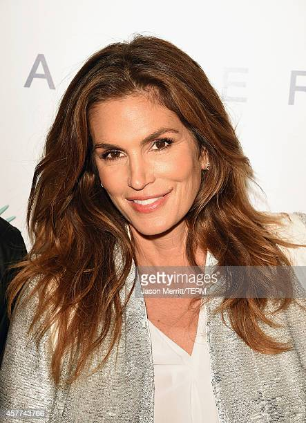Model Cindy Crawford attends the Brian Bowen Smith WILDLIFE show hosted by Casamigos Tequila at De Re Gallery on October 23 2014 in West Hollywood...