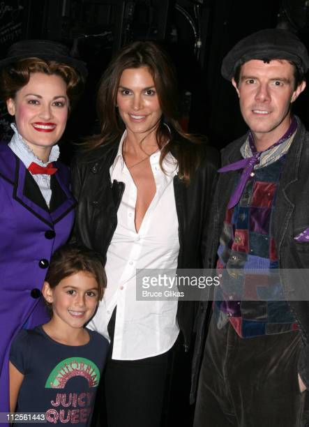 Model Cindy Crawford poses backstage with her daughter Kaya Jordan Gerber and cast members Ashley Brown and Gavin Lee as she visits 'Mary Poppins' on...