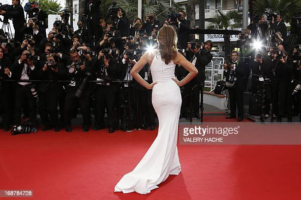 US model Cindy Crawford poses on May 15 2013 as she arrives for the screening of 'The Great Gatsby' ahead of the opening of the 66th edition of the...