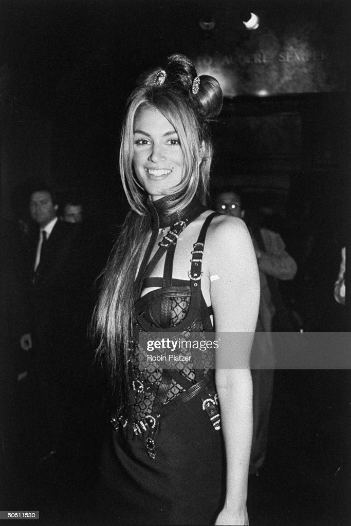 Model Cindy Crawford wearing a Gianni Versace Bondage dress at the benefit he threw for AMFAR