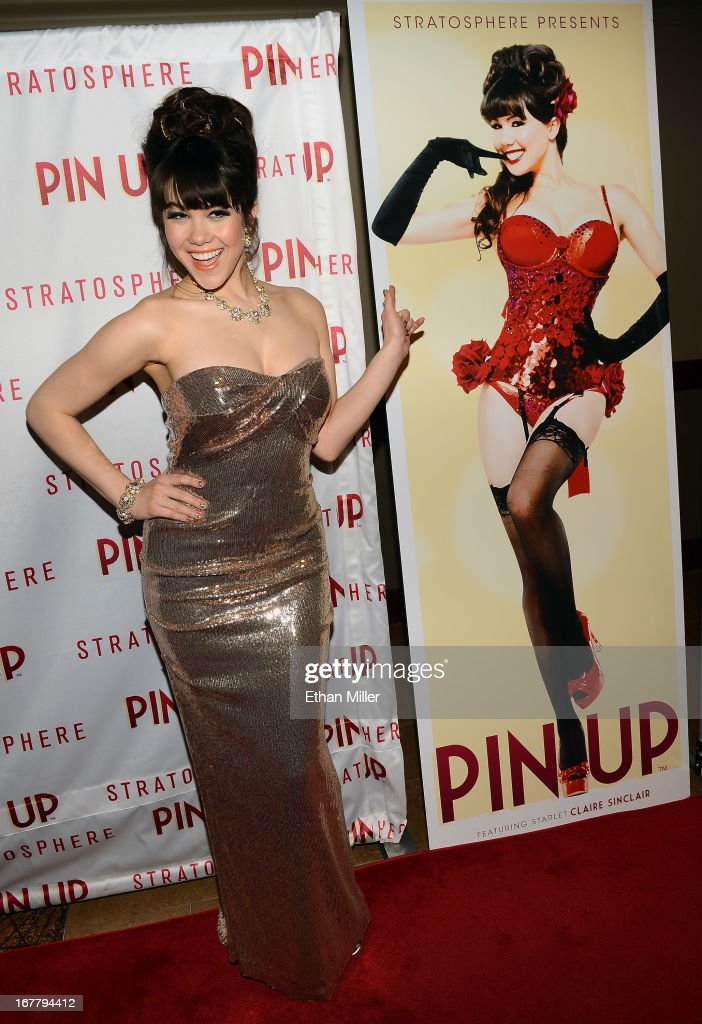 Model Claire Sinclair poses next to a poster of herself as she arrives at the premiere of the show 'Pin Up' at the Stratosphere Casino Hotel on April 29, 2013 in Las Vegas, Nevada.