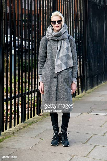 Model Claudia Kozik wears a Kate Haring hat scarf from China H and M bag Michael Kors watch Reebok shoes and Gentle Monster sunglasses on February 24...