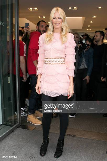 Model Claudia Schiffer poses in front of the 'COLETTE' concept store on September 28 2017 in Paris France