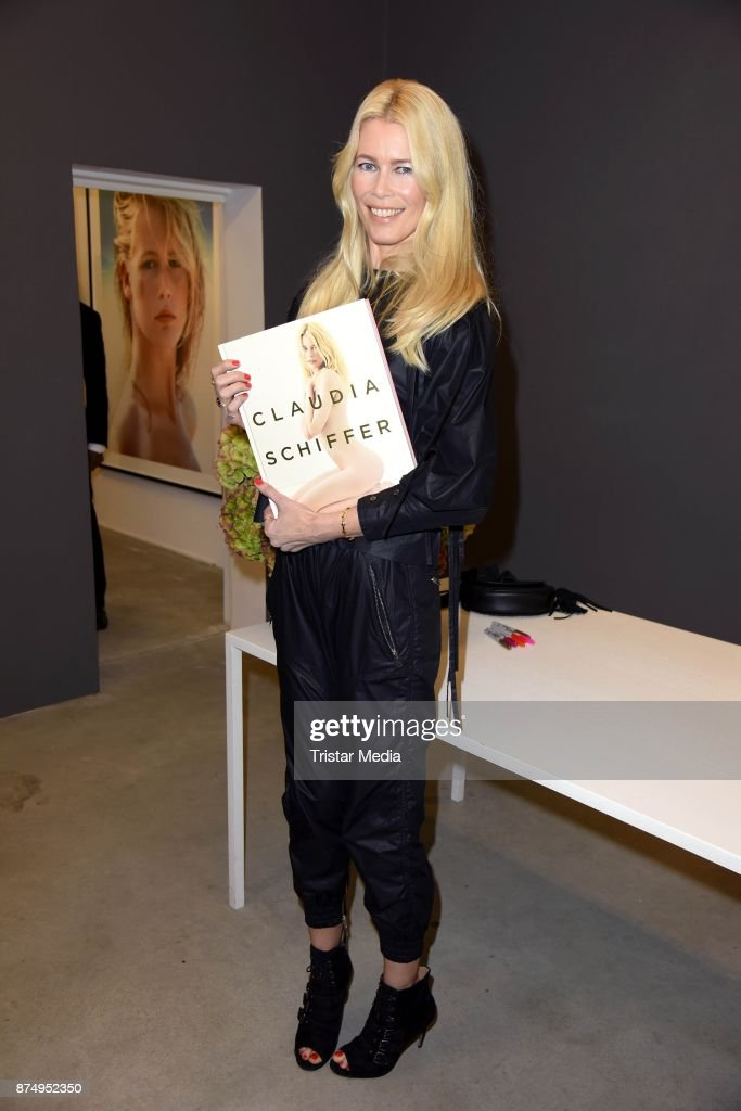 Model Claudia Schiffer signs the photo book 'Claudia Schiffer' at CWC Gallery on November 16, 2017 in Berlin, Germany.