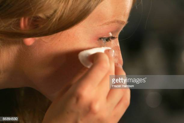 A model cleans makeup off backstage at the Bill Blass Spring 2006 fashion show during Olympus Fashion Week at Bryant Park September 13 2005 in New...