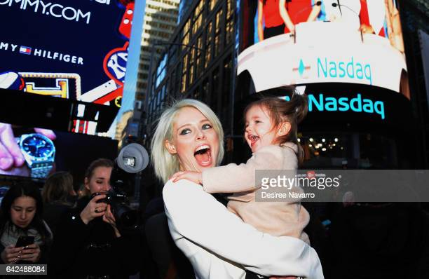 Model Coco Rocha and daughter Ioni James Conran ring The Nasdaq Closing Bell at NASDAQ on February 17 2017 in New York City