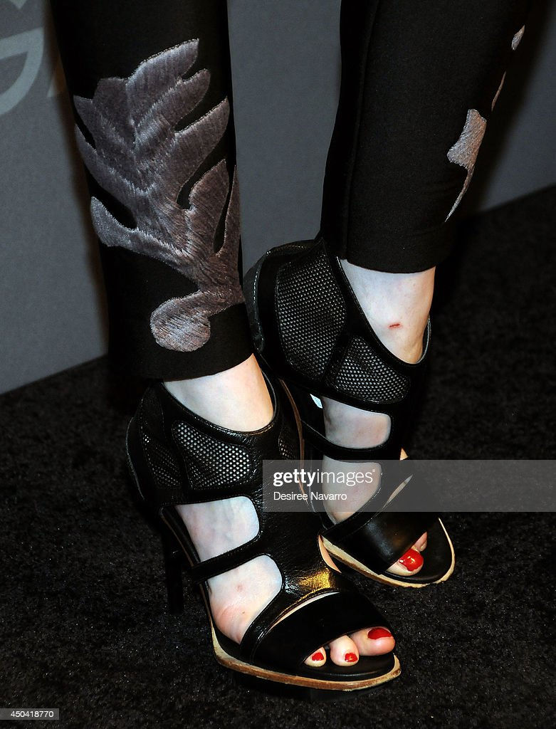 Model Coco Rocha (shoe detail) attends the OMEGA Speedmaster Dark Side of the Moon launch at Cedar Lake on June 10, 2014 in New York City.