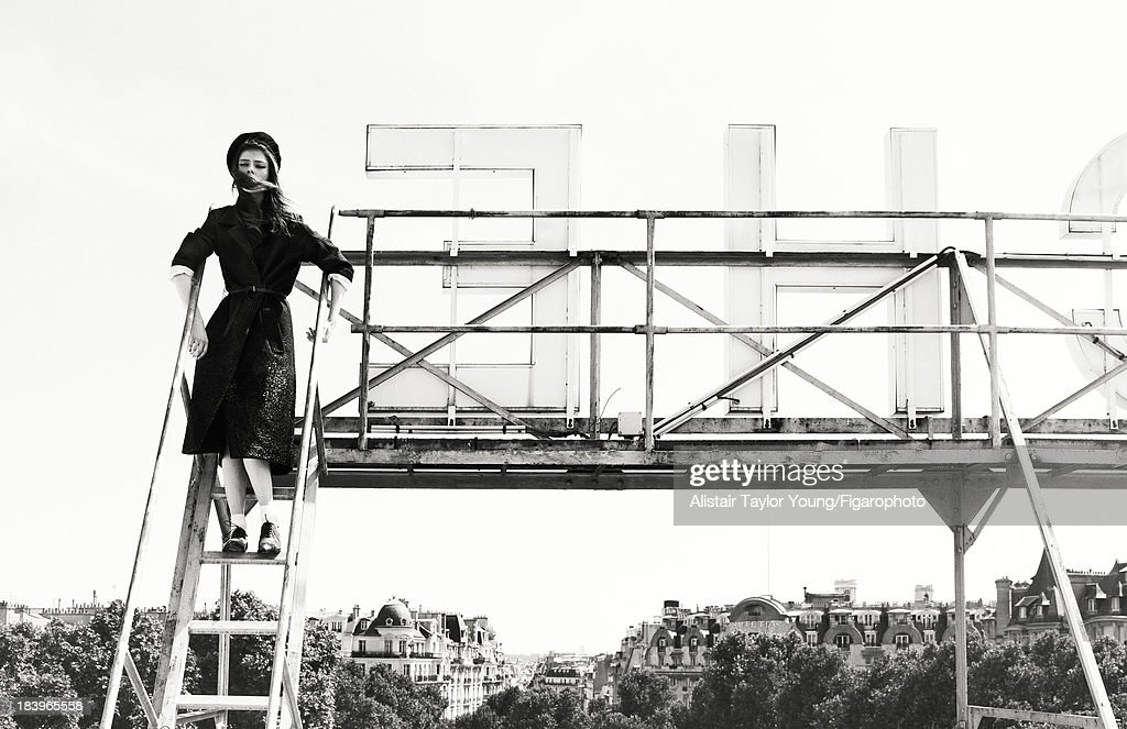 107230-005. Model Coco Rocha poses at a fashion shoot for Madame Figaro on July 19, 2013 in Paris, France. Coat (Louis Vuitton), beret (Le Bon Marche), socks (Falke), shoes (Christian Louboutin). PUBLISHED IMAGE.