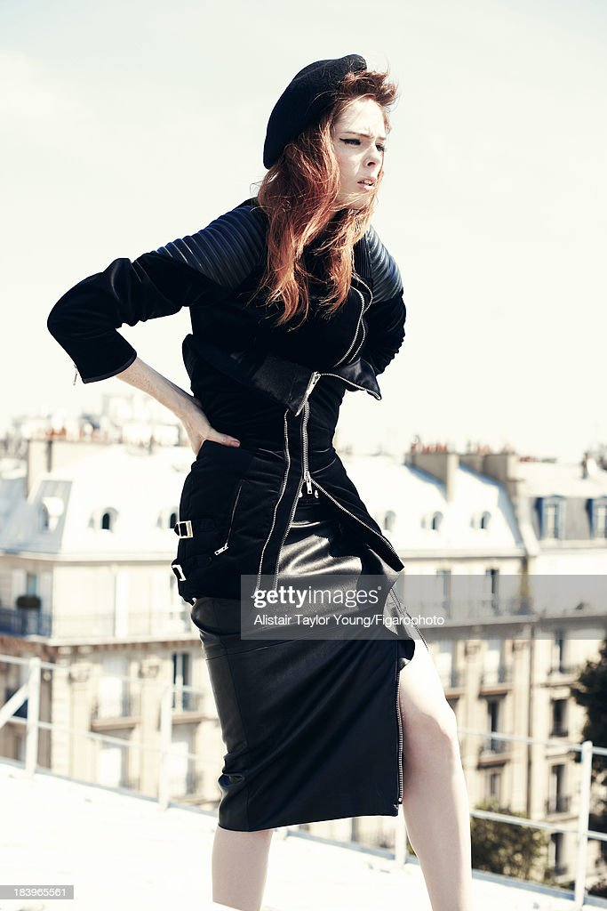 107230-008. Model Coco Rocha poses at a fashion shoot for Madame Figaro on July 19, 2013 in Paris, France. Jacket, bustier and dress (Riccardo Tisci for Givenchy), beret (Le Bon Marche). PUBLISHED IMAGE.