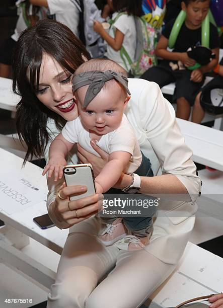 Model Coco Rocha with daughter Ioni James Conran attend Paul Frank Industries Kid's Show Front Row during Spring 2016 New York Fashion Week at Hudson...
