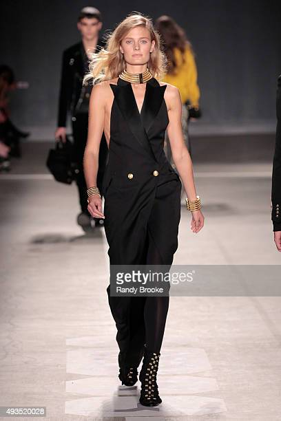 Model Constance Jablonski walks the runway at the BALMAIN X HM Collection Launch at 23 Wall Street on October 20 2015 in New York City