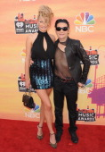 Model Courtney Anne and actor Corey Feldman arrive at the 2014 iHeartRadio Music Awards at The Shrine Auditorium on May 1 2014 in Los Angeles...