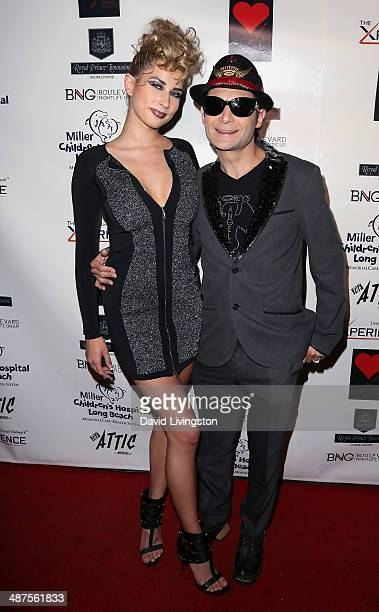 Model Courtney Anne and actor Corey Feldman attend '30 Years of Music Art Fashion' benefiting Miller Children's Hospital at The Attic on April 30...