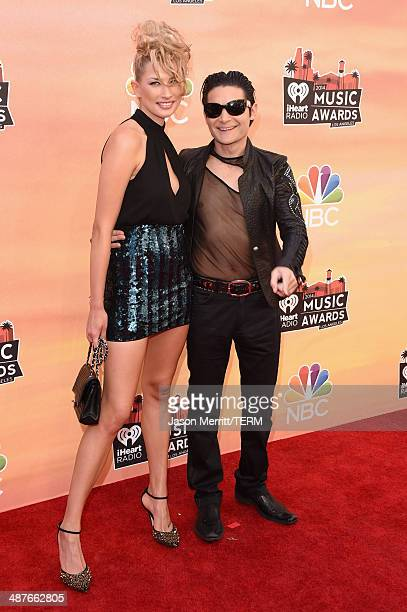 Model Courtney Anne and actor Corey Feldman attend the 2014 iHeartRadio Music Awards held at The Shrine Auditorium on May 1 2014 in Los Angeles...