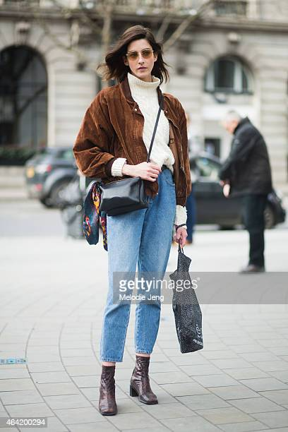 Model Cris Herrmann exits the David Koma show in a vintage outfit and Celien bag during London Fashion Week Fall/Winter 2015/16 at on February 22...
