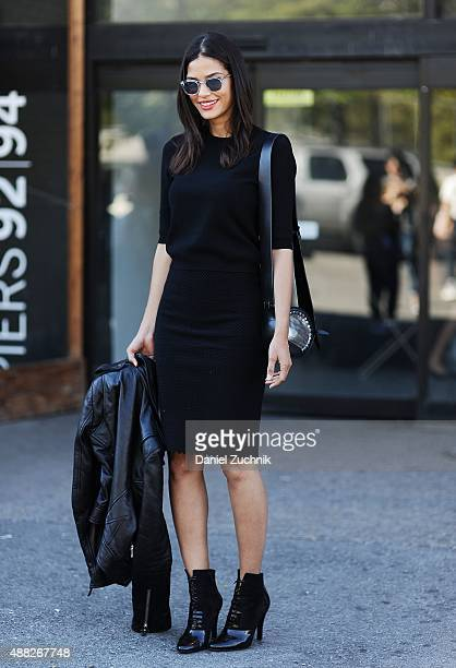 Model Cris Urena is seen outside the 31 Phillip Lim show wearing Balenciaga leather jacket Acne top Alaia skirt Phillip Lim accessories shoes and bag...