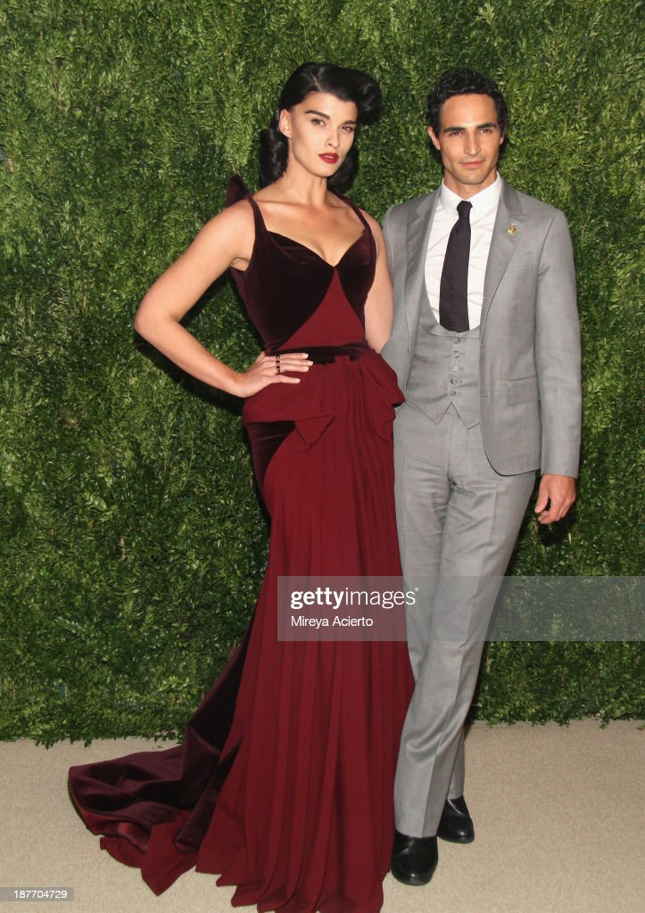 Model <a gi-track='captionPersonalityLinkClicked' href=/galleries/search?phrase=Crystal+Renn&family=editorial&specificpeople=2216376 ng-click='$event.stopPropagation()'>Crystal Renn</a> and designer Zac Posen attend CFDA and Vogue 2013 Fashion Fund Finalists Celebration at Spring Studios on November 11, 2013 in New York City.