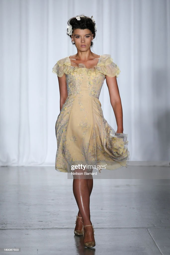 Model <a gi-track='captionPersonalityLinkClicked' href=/galleries/search?phrase=Crystal+Renn&family=editorial&specificpeople=2216376 ng-click='$event.stopPropagation()'>Crystal Renn</a> walks the runway at the Zac Posen fashion show during Mercedes-Benz Fashion Week Spring 2014 at Center 548 on September 8, 2013 in New York City.