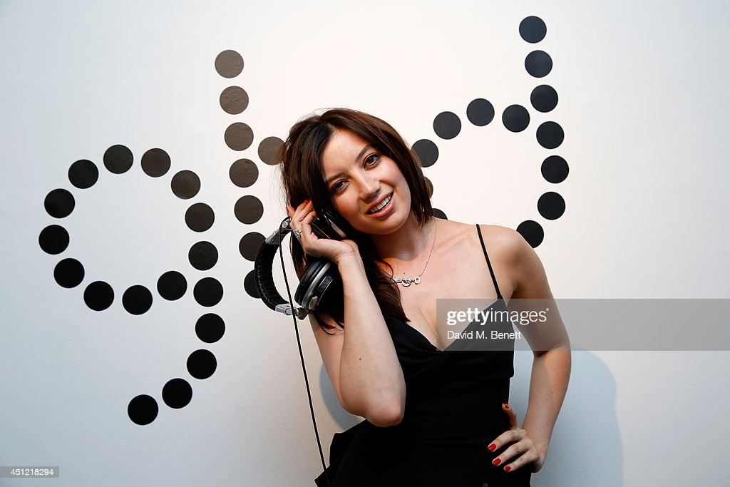Model Daisy Lowe performs as she attends ghd's exhibition of iconic beauty must-haves to celebrate the launch of ghd aura, a ground-breaking drying and styling tool on June 25, 2014 in London, England.