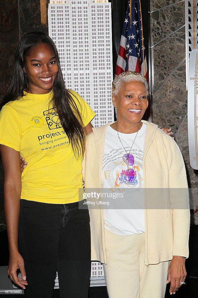 Model Damaris Lewis and signer Dionne Warwick light the Empire State Building yellow in honor of the 10th annual Project Sunshine gala on April 25, 2013 in New York City.