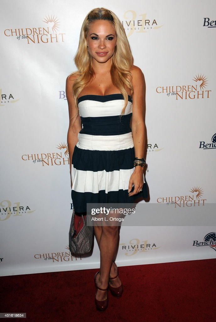 Model Dani Mathers arrives for BenchWarmer's Annual Stars & Stripes Celebration held at Riviera 31 on July 1, 2014 in Beverly Hills, California.