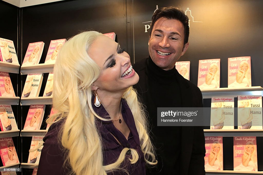 Model Daniela Katzenberger and her husband Lucas Cordalis at the Plassen stand during the 2016 Frankfurt Book Fair (Frankfurter Buchmesse) on October 22, 2016 in Frankfurt am Main, Germany. The 2016 fair, which is among the world's largest book fairs, will be open to the public from October 19-23.