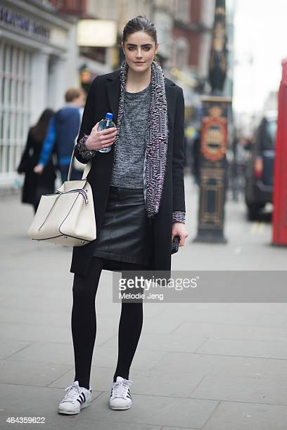 Model Daphne Velghe exits the Emilio De La Morena show in Alexander Wang a Celine bag and Adidas superstar sneakers during London Fashion Week...