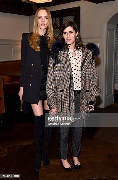 Model Daria Strokous and Rodarte founder Laura Mulleavy attend W Magazine's It Girl luncheon in partnership with Coach and Moet Chandon at AOC on...