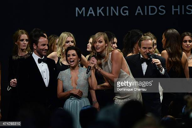 Model Daria Strokous designer Tom Ford model Lily Donladson actress Eva Longoria model Karlie Kloss and auctioneed Simon de Pury onstage during...