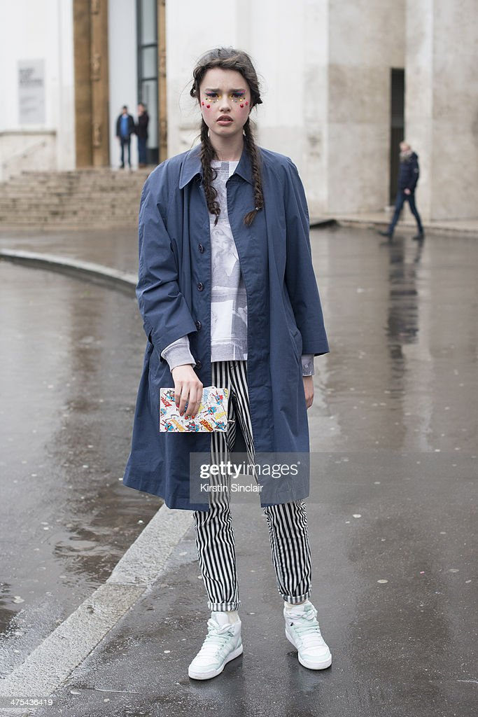 Model Dasha Bilyuk wears a Burberry jacket, Forever 21 trousers and sweater and Adidas trainers on day 3 of Paris Collections: Women on February 27, 2014 in Paris, France.