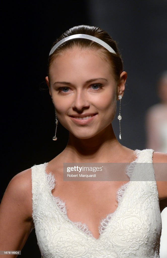 Model Dasha Kapustina walks the runway for the latest Rosa Clara bridal collection at Barcelona Bridal Week 2013 on April 30, 2013 in Barcelona, Spain.