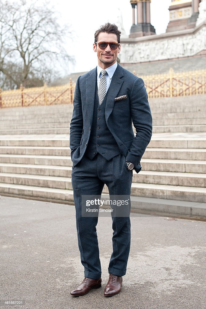 Model <a gi-track='captionPersonalityLinkClicked' href=/galleries/search?phrase=David+Gandy&family=editorial&specificpeople=4377663 ng-click='$event.stopPropagation()'>David Gandy</a> wears a a Tom Sweeney suit day 3 of London Mens Fashion Week Autumn/Winter 2014, on January 08, 2014 in London, England.