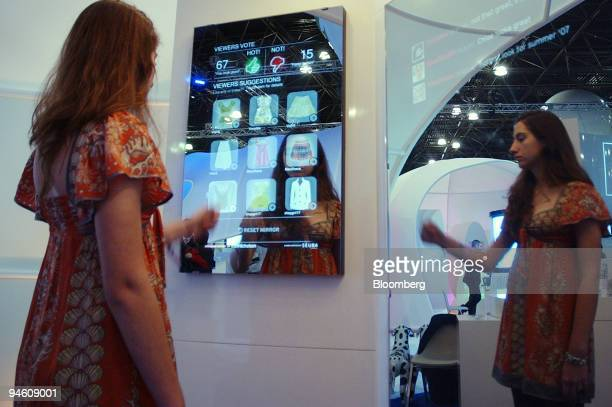 A model demonstrates the use of the Icon Nicholson Corporation's Social Retailing Display at the National Retail Federation conference in New York on...