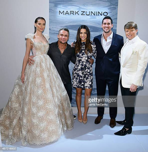 Model designer Mark Zunino television personalities Andi Dorfman and Josh Murray and Kleinfeld Bridal Fashion Director Terry Hall attend front row at...