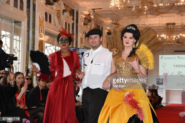 A model designer Tarquin Benel and model Caroline Cousin walksthe runway during 'Fashion Night Couture 2017' Show at Salon des Miroirs on April 26...