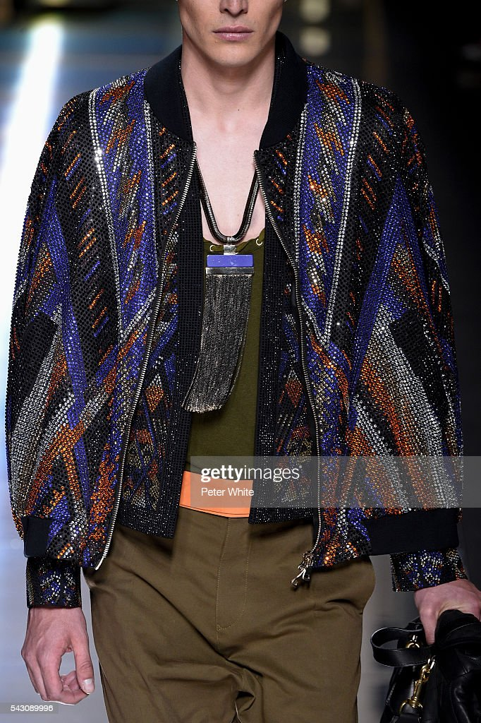 A model, detaails, walks the runway during the Balmain Menswear Spring/Summer 2017 show as part of Paris Fashion Week on June 25, 2016 in Paris, France.