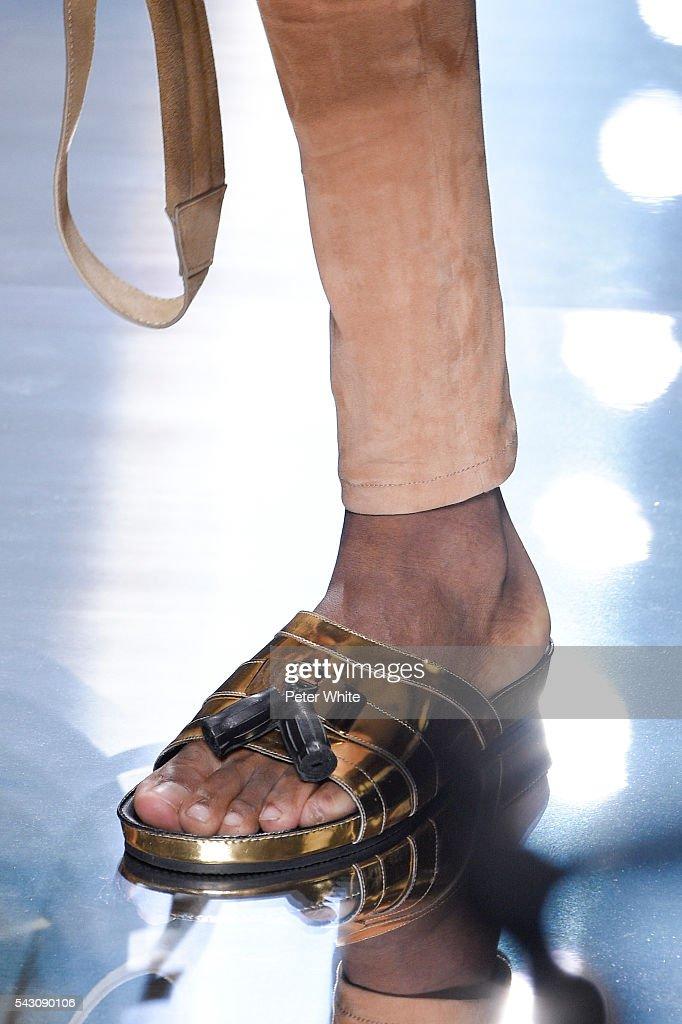 A model, details, walks the runway during the Balmain Menswear Spring/Summer 2017 show as part of Paris Fashion Week on June 25, 2016 in Paris, France.