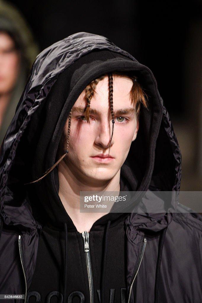 A model, details, walks the runway during the Juun.J Menswear Spring/Summer 2017 show as part of Paris Fashion Week on June 24, 2016 in Paris, France.