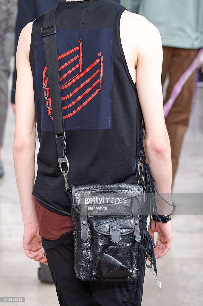 A model, details, walks the runway during the Lanvin Menswear Spring/Summer 2017 show as part of Paris Fashion Week on June 26, 2016 in Paris, France.
