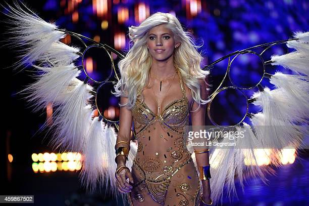 Model Devon Windsor walks the runway at the annual Victoria's Secret fashion show at Earls Court on December 2 2014 in London England