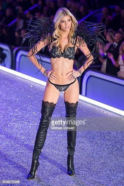 Model Devon Windsor walks the runway during the 2016 Victoria's Secret Fashion Show at Le Grand Palais in Paris on November 30 2016 in Paris France
