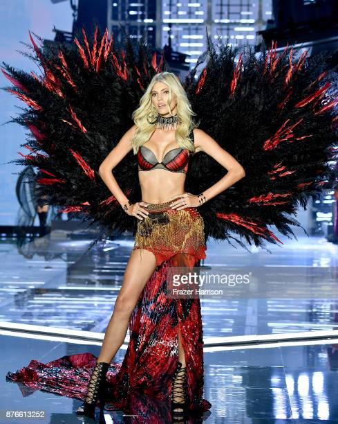Model Devon Windsor walks the runway during the 2017 Victoria's Secret Fashion Show In Shanghai at MercedesBenz Arena on November 20 2017 in Shanghai...
