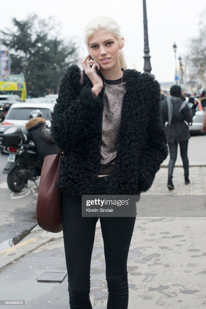 Model <a gi-track='captionPersonalityLinkClicked' href=/galleries/search?phrase=Devon+Windsor&family=editorial&specificpeople=10486182 ng-click='$event.stopPropagation()'>Devon Windsor</a> wears Isabel Marrant jacket and Joeâs trousers and top day 2 of Paris Haute Couture Fashion Week Spring/Summer 2014, on January 21, 2014 in Paris, France.
