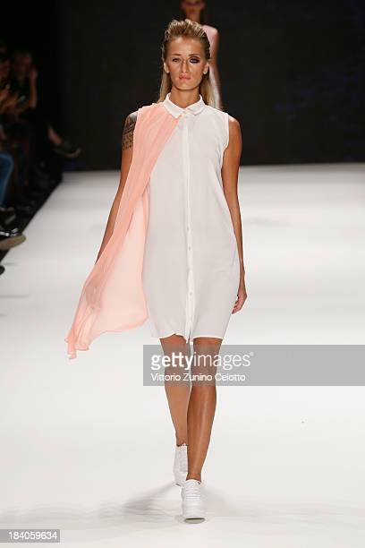 Model Didem Soydan walks the runway at the Argande show during MercedesBenz Fashion Week Istanbul s/s 2014 Presented By American Express on October...