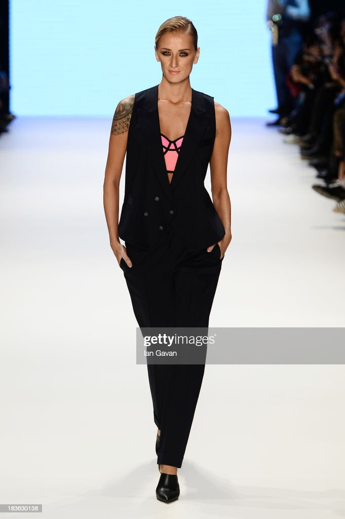 Model Didem Soydan walks the runway at the Emre Erdemoglu show during Mercedes-Benz Fashion Week Istanbul s/s 2014 presented by American Express on October 8, 2013 in Istanbul, Turkey.