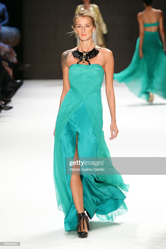 Model Didem Soydan walks the runway at the Gizia show during Mercedes-Benz Fashion Week Istanbul s/s 2014 on October 7, 2013 in Istanbul, Turkey.